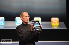 Steve Jobs holding iPad